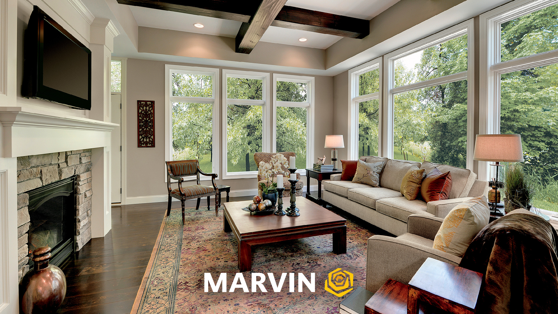 Living room with wood beams and white trim windows